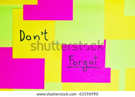 """Don't forgot"" colorful reminder note memo pad on wall"