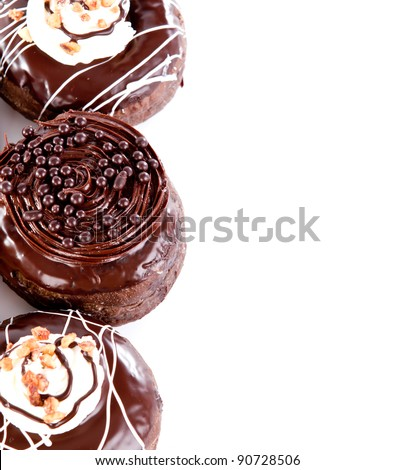 Donut with chocolate and peanut against white background - stock photo