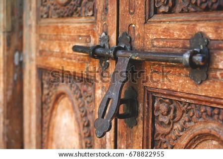 Door latch on a beautiful old teak carved door. - Door Latch On Beautiful Old Teak Stock Photo 678822955 - Shutterstock
