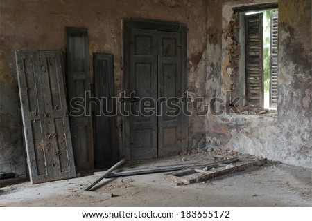 Doors against the wall in a abandoned house