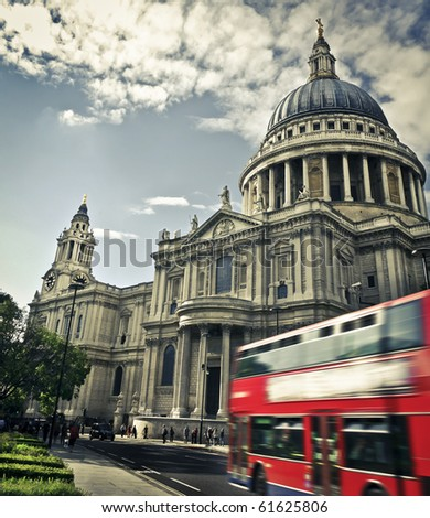 Double decker passing by front of St Paul's Cathedral. Summer sky for copy space.