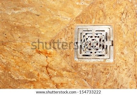 Drain hole in a bathroom - stock photo
