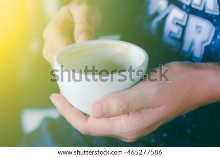 Drinking Tea or Coffee in Cafe,man relaxing on couch with coffee at coffee shop and selective focus.