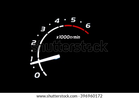 driver's cockpit ; tachometer on dashboard - white light in black - stock photo