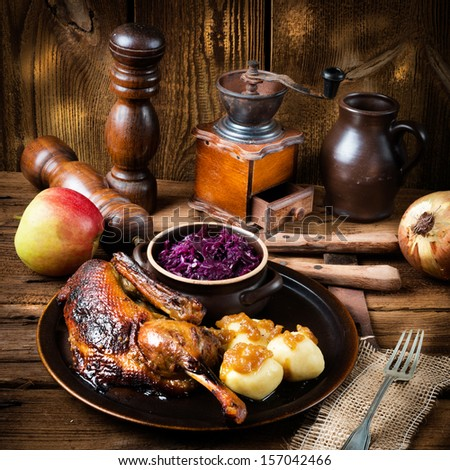 duck with dumplings and pickled plum - stock photo