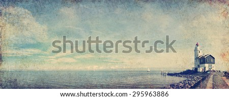 Dutch pastoral nature landscape with a small lighthouse on seacoast. Panoramic view (Marken. Netherlands).Textured old paper background. Aged textured photo .Photo in retro style - stock photo