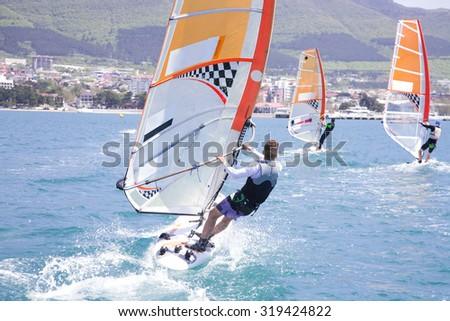 dynamic race on windsurfing in the sea - stock photo
