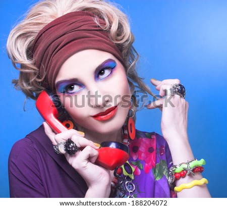 80-ears style. Young woman with bright visage with vintage telephone. - stock photo