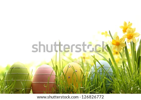 Easter eggs decorated with grass and flowers. - stock photo