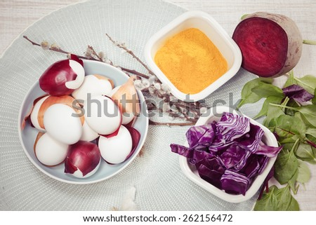 Easter eggs dyeing. Dyeing Easter eggs natural way.  Naturally dyed Easter eggs with onion skins, red cabbage, beet, turmeric, spinach. Macro, selective focus - stock photo
