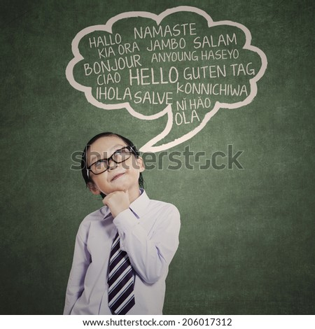 Education concept: schoolboy learn many languages in a classroom  - stock photo