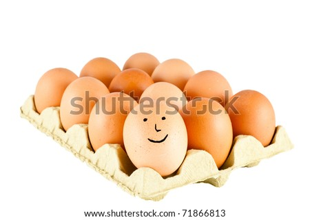 12 eggs in a carton one with a smiling face - stock photo