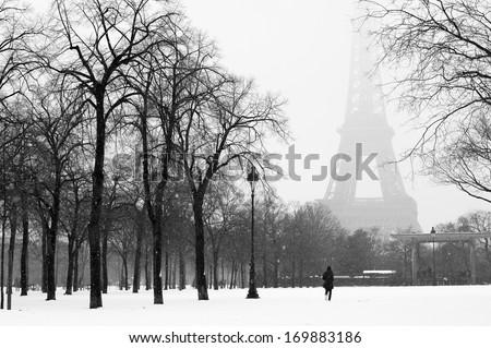 Eiffel tower and champ de Mars in snow, Paris, France - stock photo
