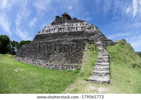"""""""El Castillo"""" rises 130 ft at Xunantunich, an ancient Mayan archeological site in western Belize, close to Guatemala. The city was a ceremonial center abandoned around AD 750 due to a violent event. - stock photo"""