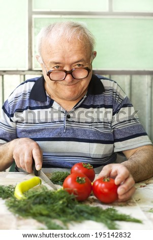 elderly man preparing healthy food - stock photo