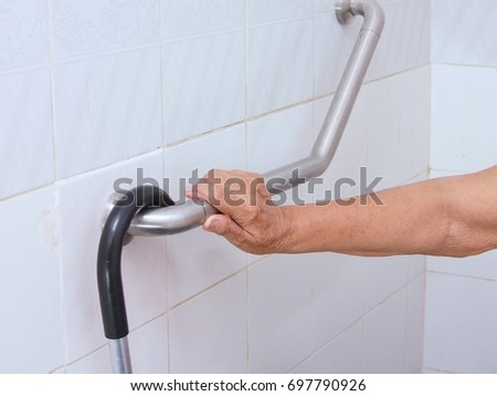 Awesome Elderly Woman Holding Handrail In The Bathroom.concept Safety In The  Bathroom.