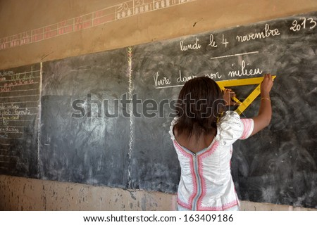elementary school teacher in Africa  - stock photo