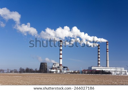 emissions of industrial enterprises in the frosty winter day. - stock photo