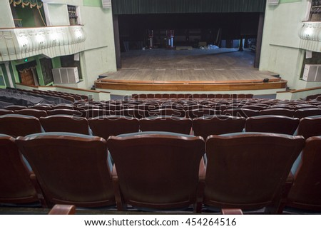Empty rows of blue chairs in the auditorium of the theater - stock photo