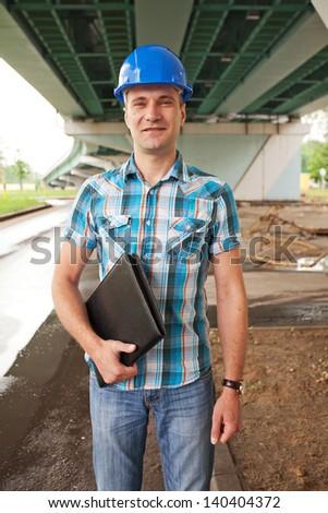 Engineer under a bridge - stock photo