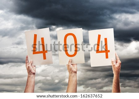 404 error, page not found. hands holding paper with printed numbers. - stock photo