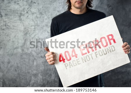 404 error, page not found. Web designer holding paper with printed error web page. Internet technology concept. - stock photo