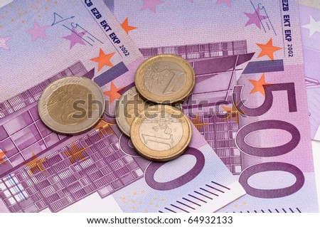 500 euro and coins - stock photo