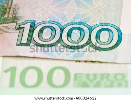 100 euro and 1000 roubles banknotes, close up