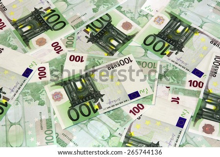 100 Euro bank notes scattered background - stock photo