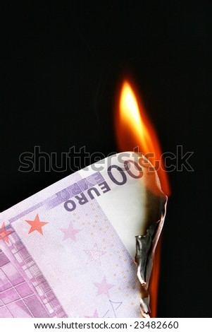 500 euro banknote on fire over black background - stock photo