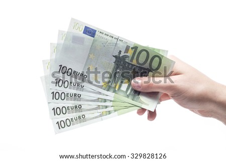 100 euro banknotes hold in hand isolated on white background - stock photo