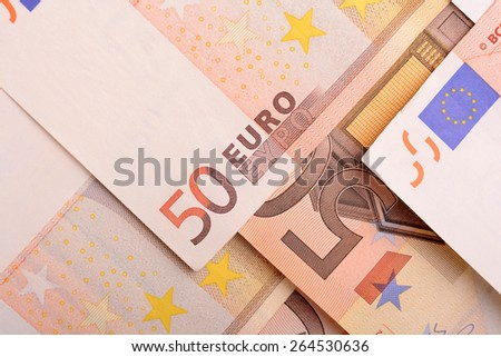 50 euro banknotes in a row. European Union Currency. Stack of 50 euro banknotes - stock photo