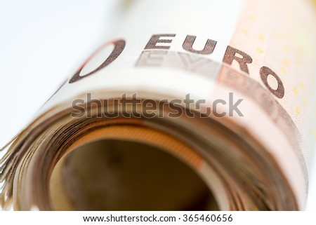 50 euro banknotes rolled and wrapped together - stock photo