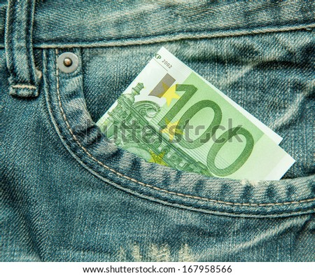 100 euro bill in the pocket of jeans - stock photo