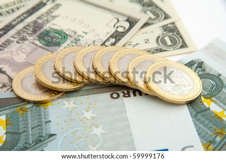 Euros and dollars isolated on white background - stock photo