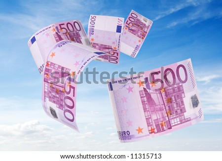 500 euros bill flying away blue sky as background - stock photo