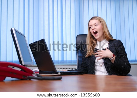 .excited businesswoman working on her laptop