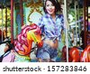 Excited Lively Woman in Funfair Smiling. Rejoicing & Enjoyment - stock photo