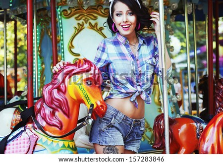 Excited Lively Woman in Funfair Smiling. Rejoicing & Enjoyment