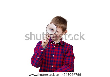 Exploring little boy with magnifying glass on white background. - stock photo