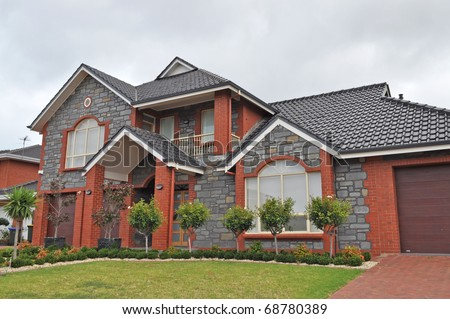 Exterior facade of a Australian home, Cloudy day - stock photo
