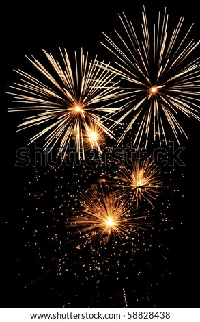 """""""Family"""" of fireworks: """"mom"""" and """"pop"""" bursts and three baby bursts, with glitter - stock photo"""
