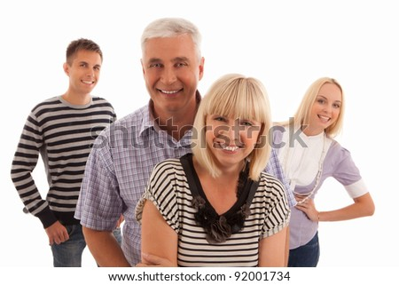 family of four people looking at the camera portrait isolated on white background - stock photo