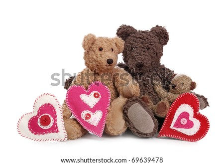 Family of teddy bears with hearts - stock photo