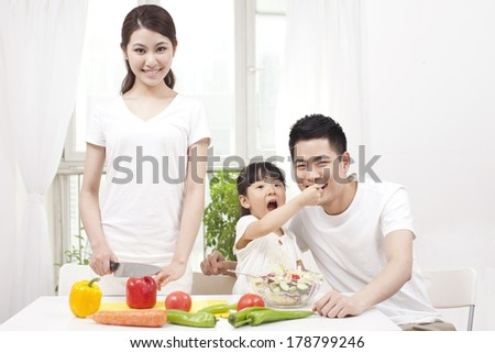 Family preparing a salad - stock photo