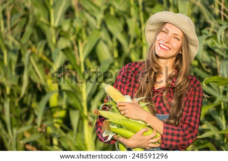 Farmer with corn, outdoor portrait - stock photo