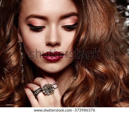 Fashion girl portrait  on a silvery background.Accessorys. Long curly hairs - stock photo