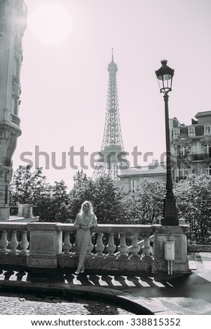 Fashion young blonde woman portrait in Paris.