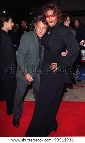 """11FEB98:  Actor DUSTIN HOFFMAN & actress QUEEN LATIFAH at premiere of their new movie, """"Sphere"""" in which they star with Sharon Stone & Samuel L. Jackson. - stock photo"""