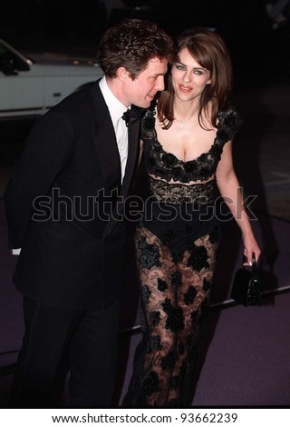 16FEB97:  HUGH GRANT & ELIZABETH HURLEY arriving at the Pantages Theatre, Hollywood, for Elizabeth Taylor's birthday celebration gala.    Pix: PAUL SMITH